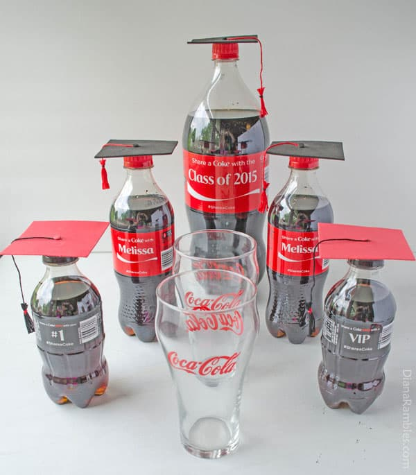display of coke bottles and glasses for a graduation gift