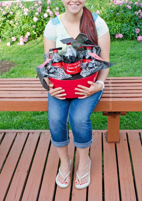 proud graduate with her Coke gift basket