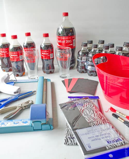 supplies for a Coke-themed graduation gift basket