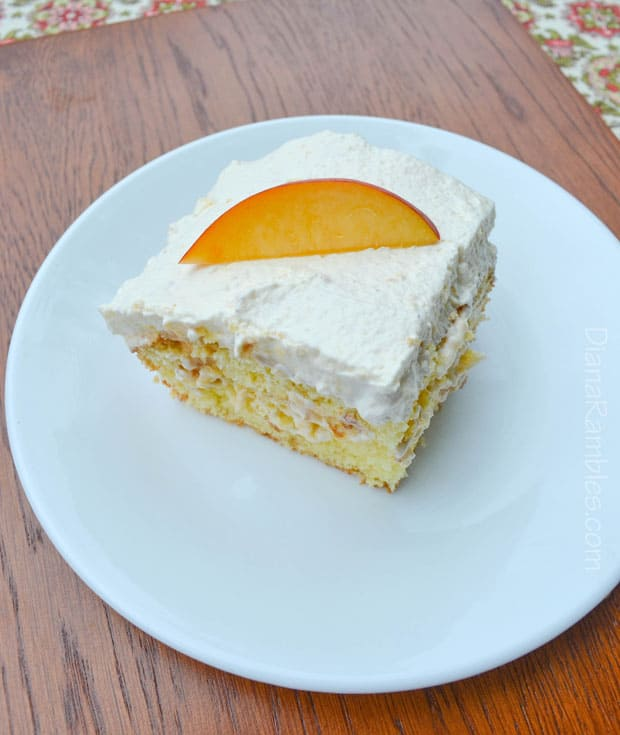 Peach Poke Cake - Love peaches? Enjoy the taste of summer with this Fresh Peach Poke Cake recipe. This moist cake is easy to make and everyone will love it!