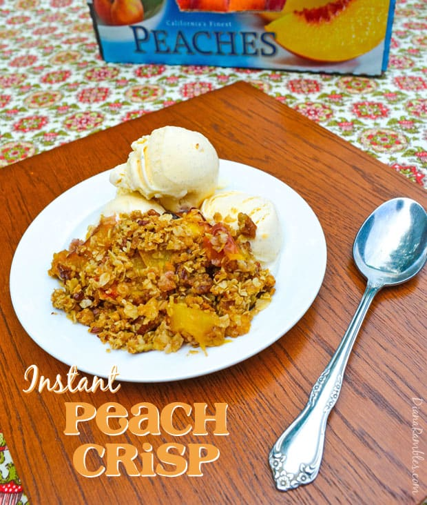 serving of peach crisp on a plate with ice cream