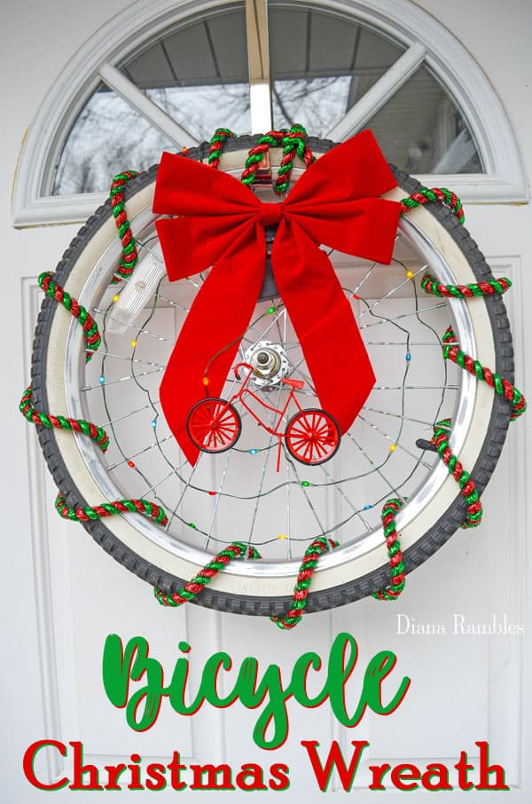 Bicycle Christmas Wreath - Create a unique Christmas wreath with an old bike tire. #Christmas #wreath