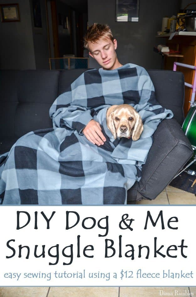 boy and dog snuggling under a snuggie for dogs