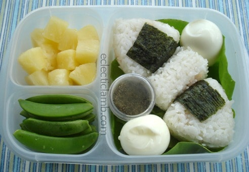 Onigiri Rice Balls Filled With Black Beans Cheddar Cheese And Salsa Dried Seaweed Hard Boiled Eggs Boston Lettuce Leaves Pepper Pineapple