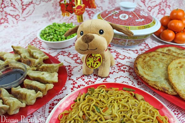 Chinese New Year Meal with a stuffed animal dog