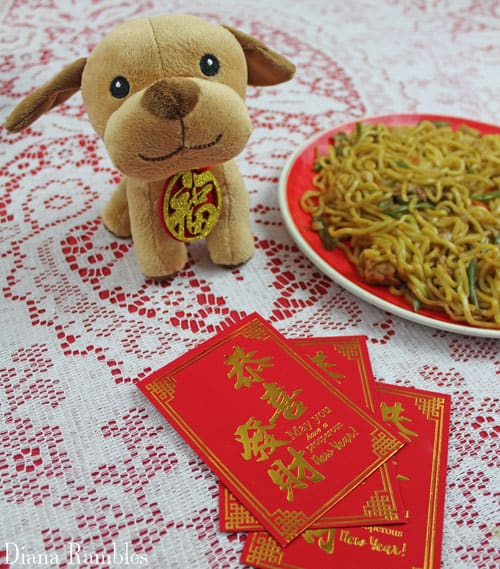 Chinese New Year of the Dog stuffed animal and red envelopes