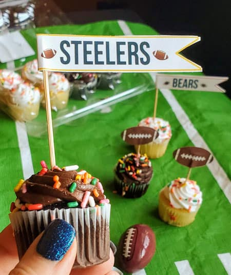 chocolate cupcake with a football cupcake topper in it
