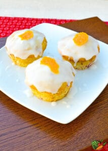 white plate with 3 muffins with glaze on them