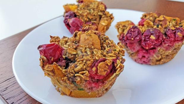 close up of 3 vegan cranberry muffins