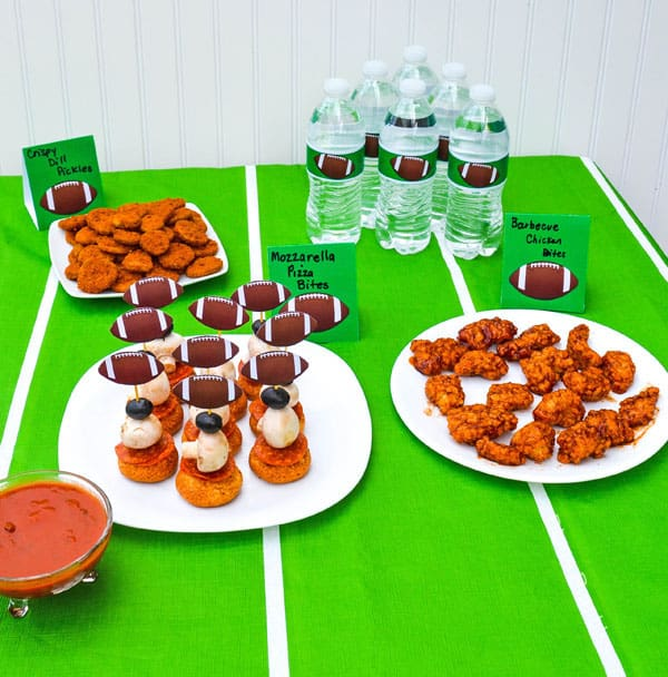 football party food on a green table covering
