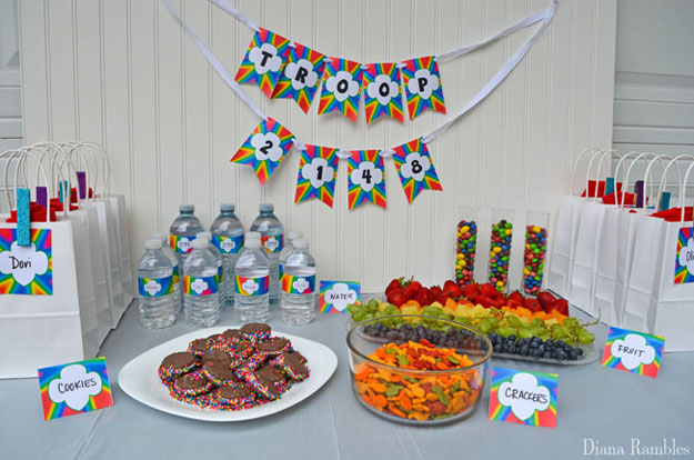 display of rainbow party food and gift bags