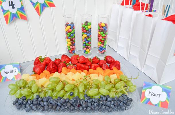 rainbow fruit salad arranged on a platter