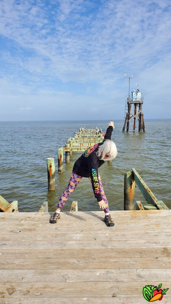 woman taking an exercise class on a pier