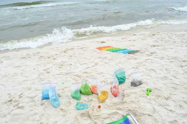 bags of colored sand on the beach