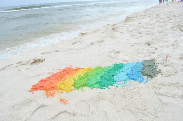 a rainbow of colored sand on the beach