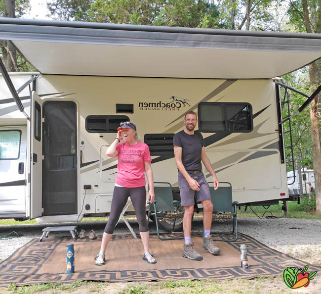 couple goofing around outside of a motorhome