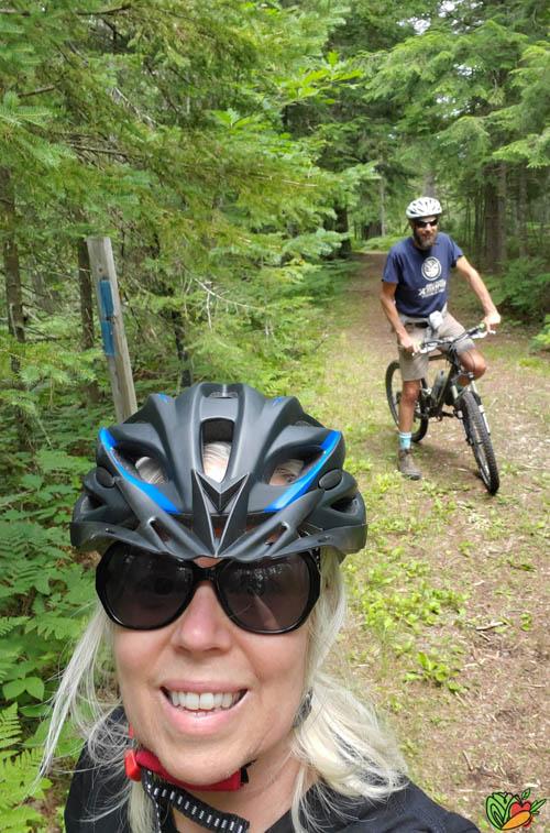selfie of a mountain biking couple